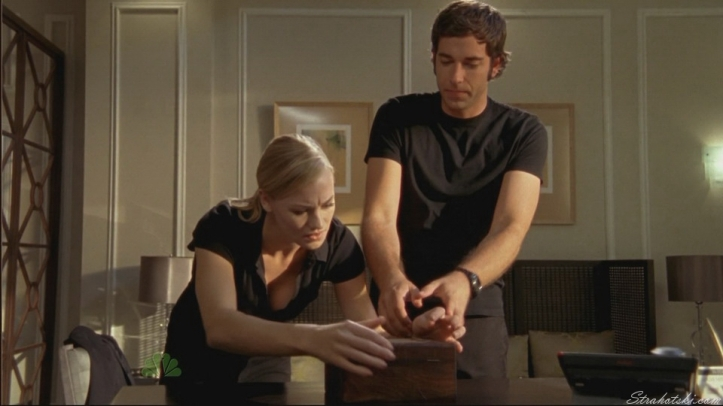 Sarah and Chuck trying to figure out the puzzle box