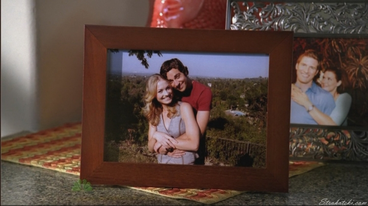 Jill spots the picture on Chuck's mantle