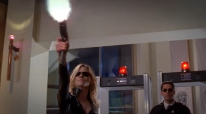Sarah taking out bank guards