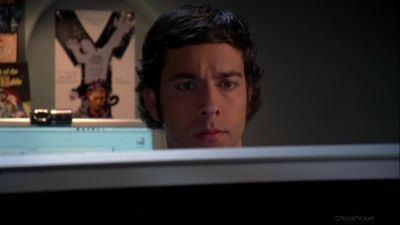 Chuck studying the Tron poster