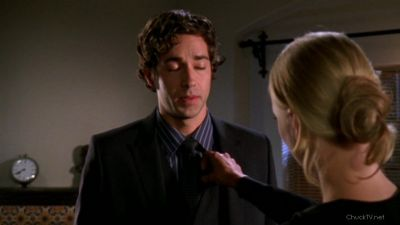 Sarah fixing Chuck's tie with feeling
