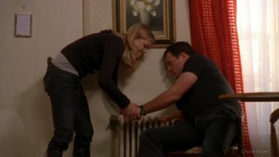 Sarah handcuffing Casey