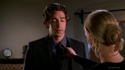 Sarah fixing Chuck's suit